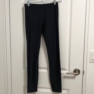 American Apparel shinny black leggings. Size L